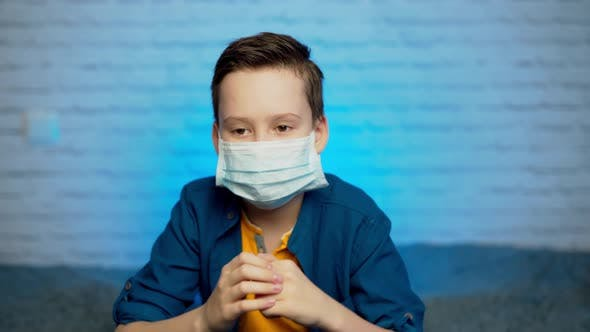 Thumbnail for Boy wearing medical mask protection