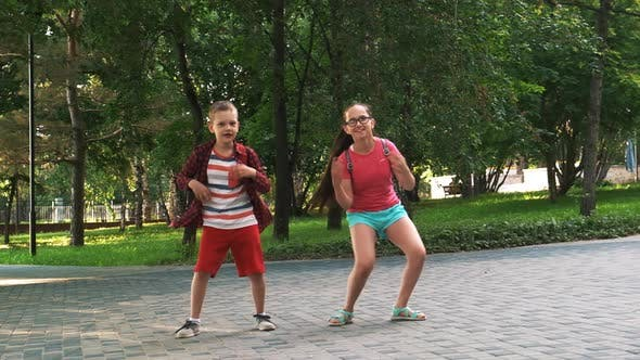 Thumbnail for Brother and Sister Are Dancing on the Street After School Lessons.