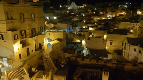 Suggestive and picturesque view of Matera at night - italy