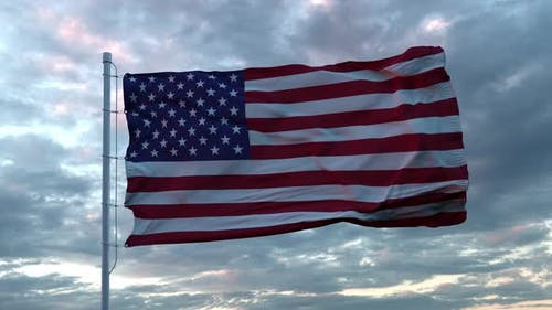 Realistic Flag of United States Waving in the Wind Against Deep Dramatic Sky. UHD 60 FPS Slow-Motion