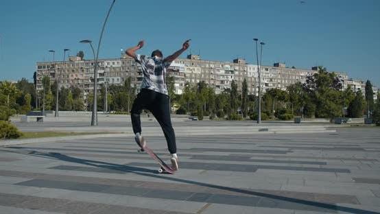 Thumbnail for Young Man Skateboarding, Doing Kickflips, Street Sports,