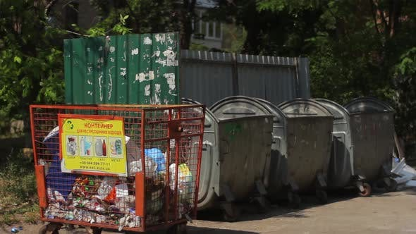 Thumbnail for A Man Throws Garbage in the Trash. Kyiv. Ukraine