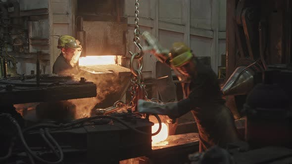 Male Forging Shop Workers Working Hard
