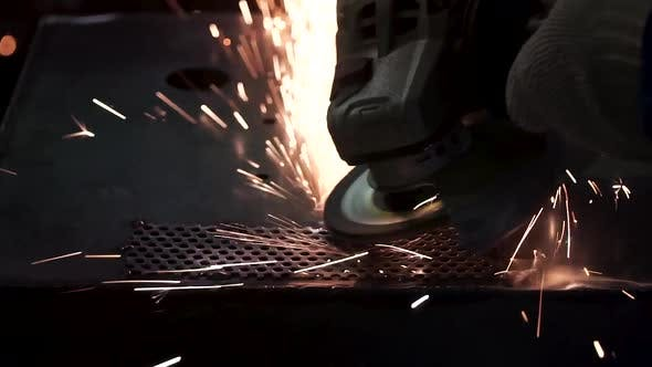 Metal Polishing With A Hand Sander With A Polishing Disk