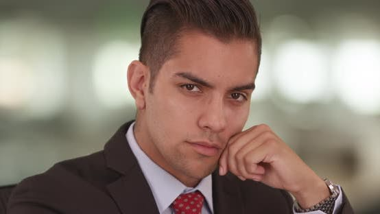 Thumbnail for Close up portrait of Hispanic business man looking at camera wearing suit and tie