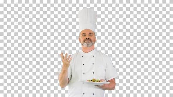Senior chef add spices in salad, Alpha Channel