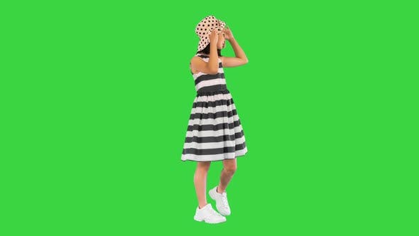 Summer Little Girl in Sundress and a Hat on a Green Screen Chroma Key