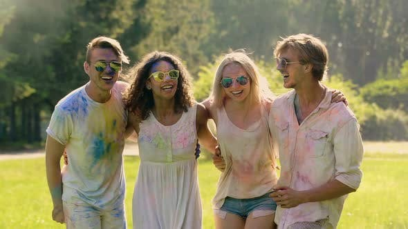 Thumbnail for Group of Friends Covered in Colored Paint Dancing, Cheering at Outdoor Party
