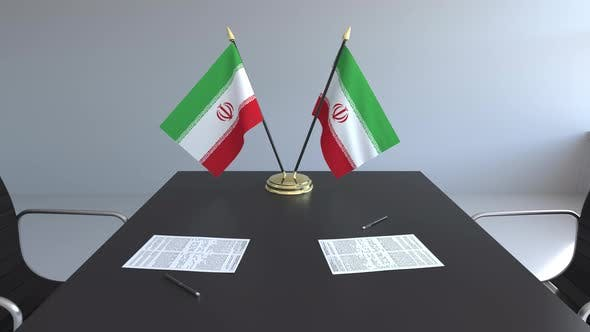 Flags of Iran and Papers on the Table