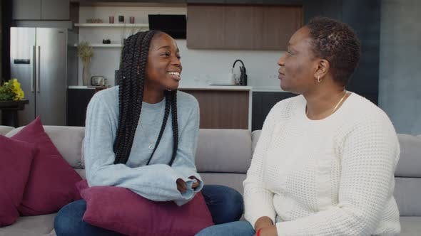 Caring Mother Soothing Troubled Teenage Daughter