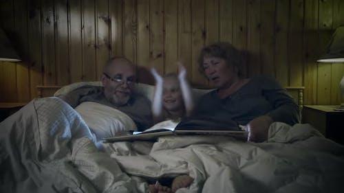 Grandparents read to grandchild