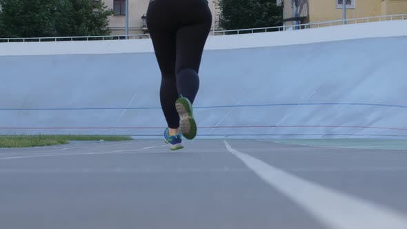 Thumbnail for Plus Size Sporty Female Jogging on City Stadium