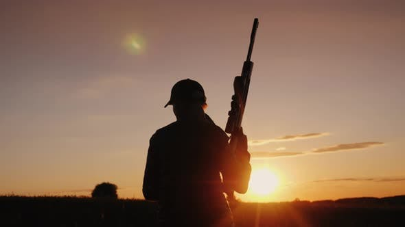 Thumbnail for A Woman with a Gun Goes Across the Field