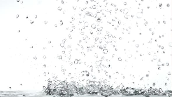 Super Slow Motion Drops of Water Fall on the Table