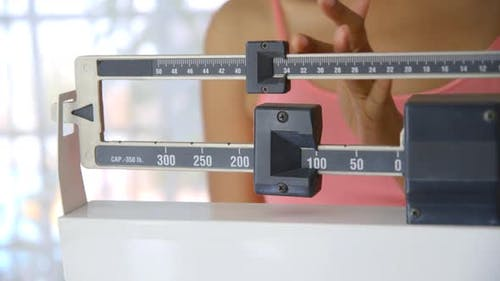 Close up of hand adjusting scale