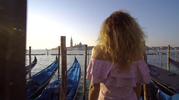 Thumbnail for Girl Walking on the Water Deck Near Gondolas