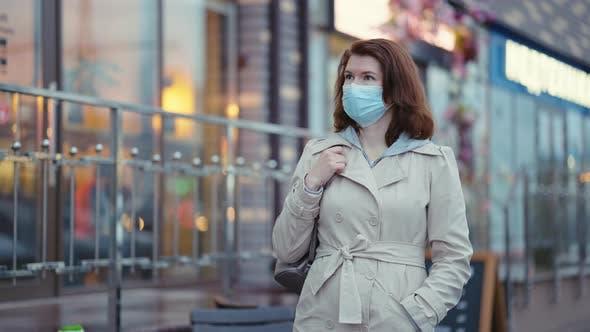 Woman in Mask Walking in Empty City