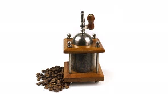 Thumbnail for Rotating Retro Coffee Grinder With Coffee Beans.4