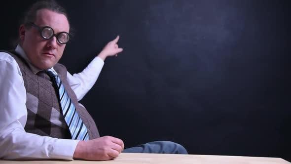Thumbnail for Nerdy Boss Explains At A Desk