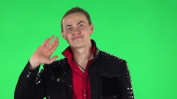 Cover Image for Guy Waving Hand and Showing Gesture Come Here. Green Screen