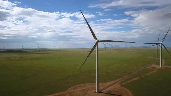Aerial of blades of windmill rotating in the wind farm