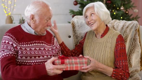 Thumbnail for Elderly Woman Giving Christmas Present to Husband