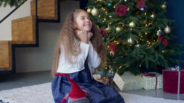 Thumbnail for Joyful Dreamy Girl Making a Wish for Christmas