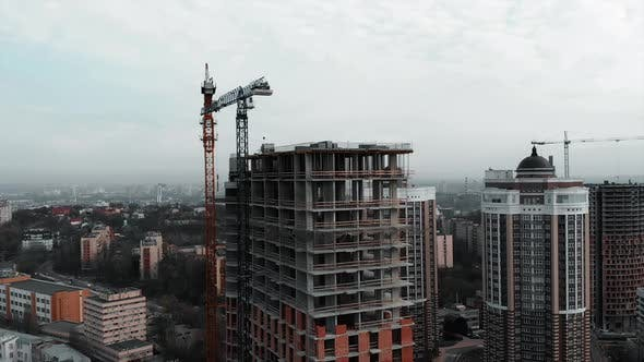 Thumbnail for High Crane Near Unfinished Building in Industrial City with Skyscrapers