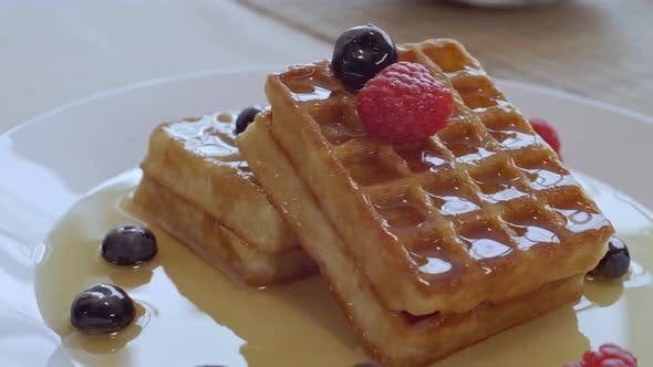 Waffles with Berries and Syrup