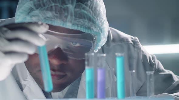Scientist Looking At Test Tubes