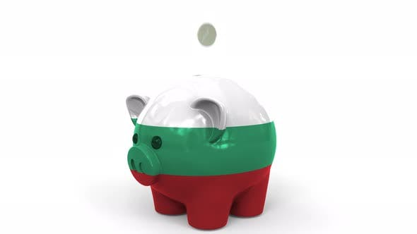 Coins Fall Into Piggy Bank Painted with Flag of Bulgaria