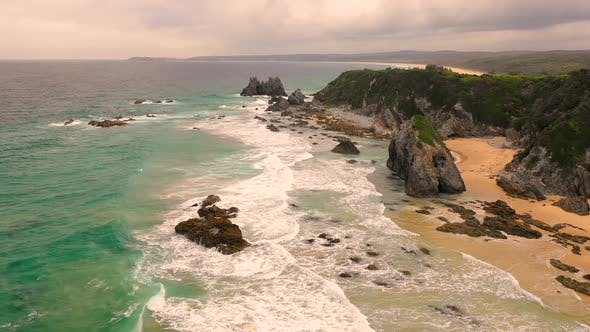 Thumbnail for Aerial view of the hidden beach at a national park, Victoria, Australia.