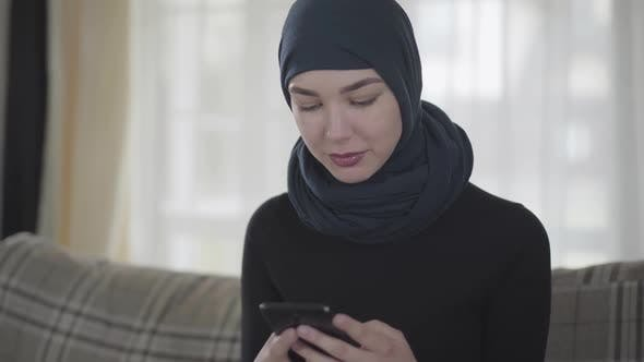 Thumbnail for Young Beautiful Eastern Woman in the Black Clothes and Beautiful Headdress Calling By Cell Phone