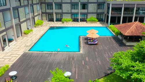 Aerial Top View of Family in Swimming Pool From Above Happy Mother and Kid Swim and Have Fun in