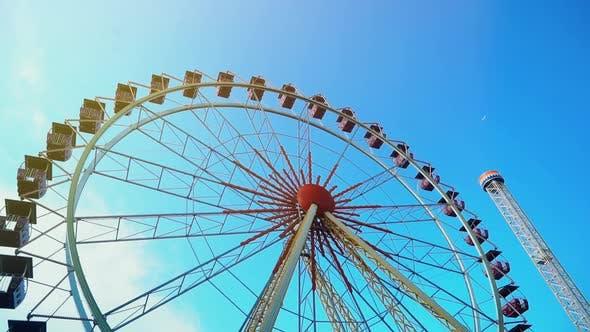 Thumbnail for Ferris Wheel Over Blue Sky