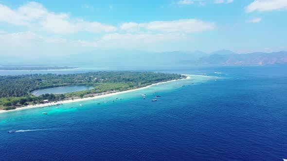 Thumbnail for Wide angle fly over copy space shot of a paradise sunny white sand beach and turquoise sea background