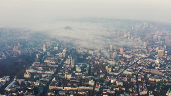 Thumbnail for Aerial View Above To Very Dense Morning Fog Over City. Smog or Fog in the City. Problem of Pollution