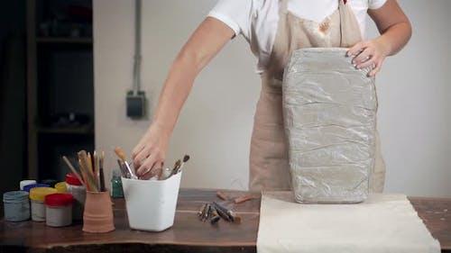 Female Ceramist at Workshop