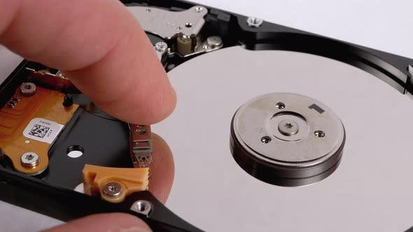 Thumbnail for Finger Touches To the Recording Head Open Hard Drive. Hard Disk Drive Inside