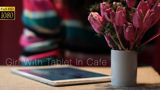 Thumbnail for Girl With Tablet In Cafe