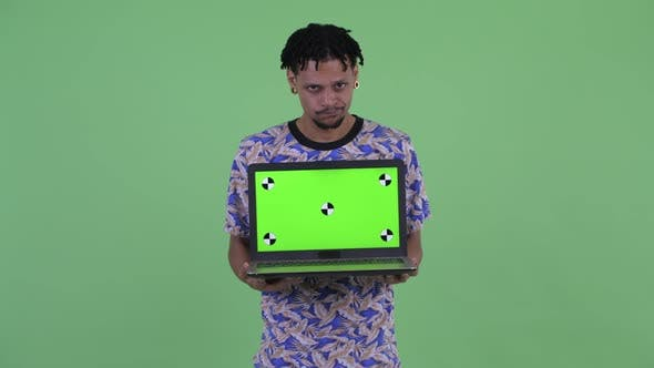 Thumbnail for Stressed Young African Man Showing Laptop