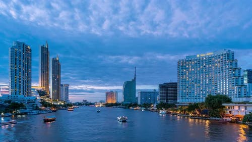Bangkok city center financial business district, waterfront cityscape, day to night - Time Lapse