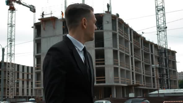 Cover Image for Businessman Walking Near Construction