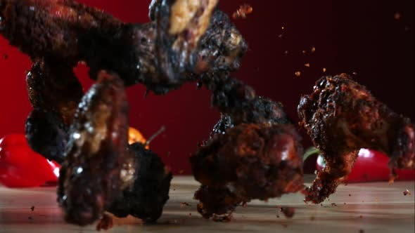 Smoked chicken wings falling and bouncing in ultra slow motion 1500fps - CHICKEN WINGS PHANTOM 036