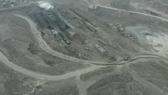 Thumbnail for Heavy Equipment Digs and Hauls Ore Inside an Enormus Open Pit Mine.