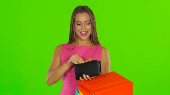 Thumbnail for Girl with Credit Card and Shopping Bags. Green Screen