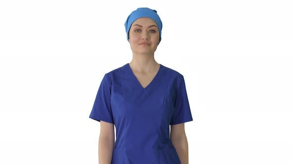 Thumbnail for Confident Nurse or Doctor in Blue Uniform Walking Towards the Camera on White Background.