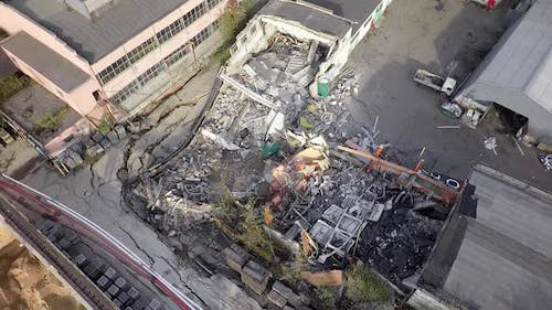 Aerial shot of destructed warehouse on plant territory