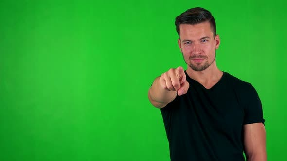 Thumbnail for Young Handsome Caucasian Man Points To Camera with Finger - Green Screen