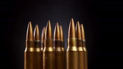 Gold Rifle Ammunition on Black Background